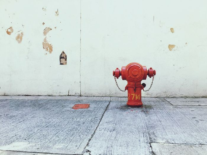 Fire hydrant at roadside in Hong Kong. Firefighter Fireplug Firepump EyeEm Selects Fire Hydrant Security Red Protection Safety Wall - Building Feature Water Accidents And Disasters Emergency Equipment Valve