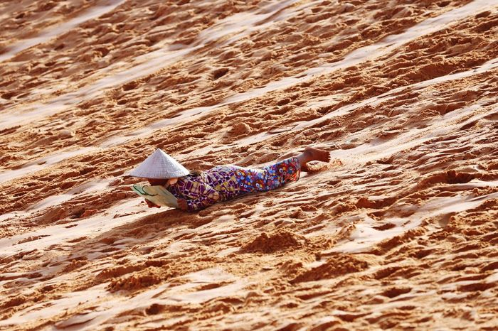 Woman Hawker Sliding Beach Sand Real People One Person Day Outdoors Nature Sand Dune People