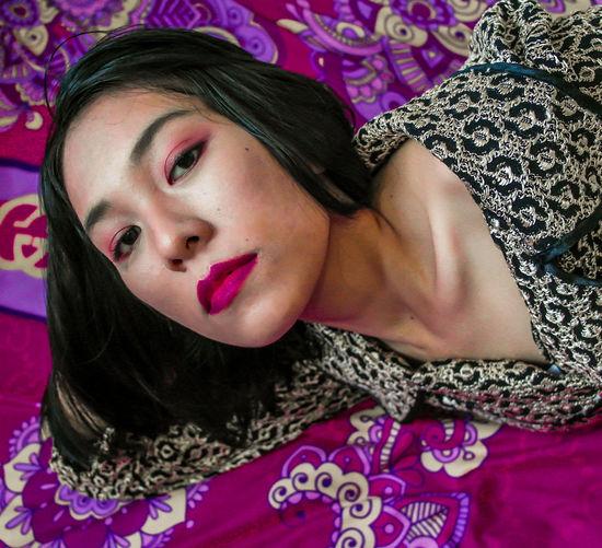 Portrait of beautiful woman lying down