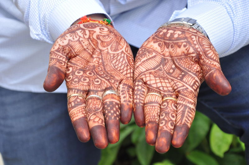 EyeEmNewHere EyeEm Best Shots Eyemphotography Light And Shadow Mehandi  Freshness Indian Wedding Men Red Color Human Hand Low Section Life Events Wedding Pattern Midsection Cultures Wedding Ceremony Groom Wedding Vows Traditional Culture Traditional Ceremony Ceremony