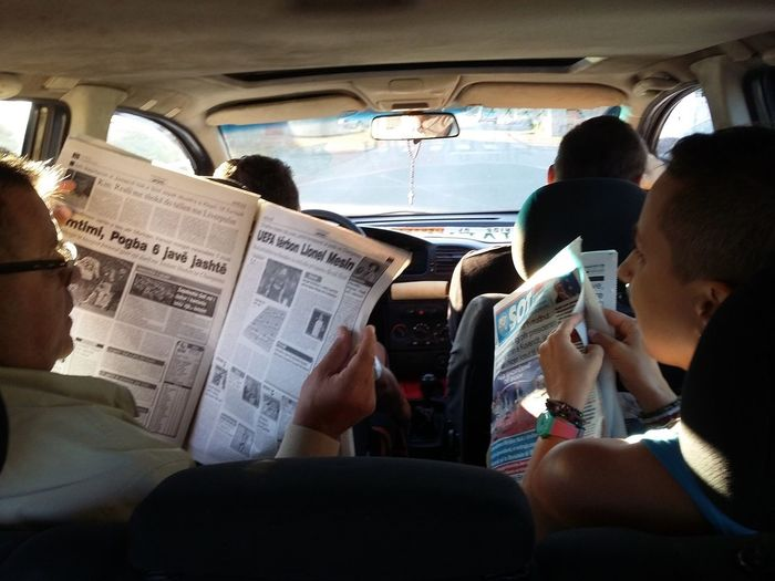 Fresh News News Reading Reading Newspaper Hitchhiking Hitchhiker Newspaper Vehicle Interior Car Real People Transportation Car Interior Mode Of Transport Land Vehicle Travel Journey Togetherness Day Two People Lifestyles EyeEmNewHere