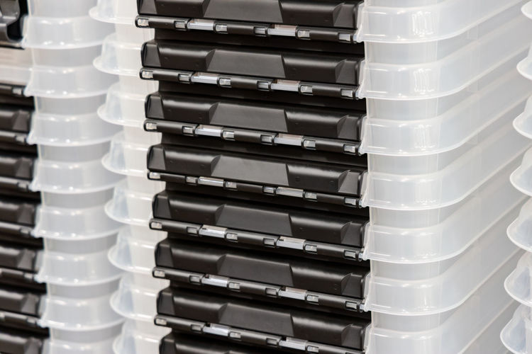 Close-up of stack of plastic containers