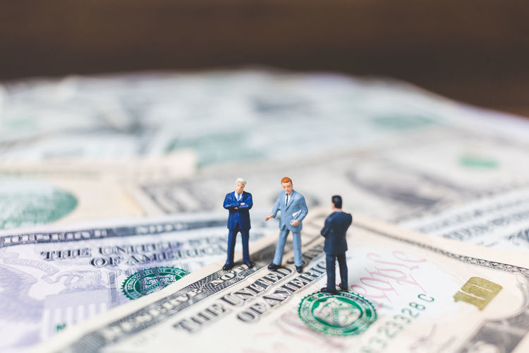 Background Business Businessman Cash Coin Concept Currency European  Figure Finance Financial Human Income Investment Little Male Man Mini Miniature Model Money People person Rich Success Suit Tax Tiny Wealth Work