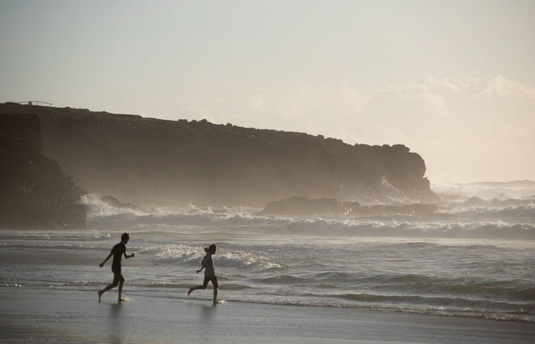 boys on a beach Beach Beauty In Nature Land Leisure Activity Lifestyles Men Motion Nature Outdoors People Real People Scenics - Nature Sea Sky Sport Surfing Togetherness Two People Water Wave