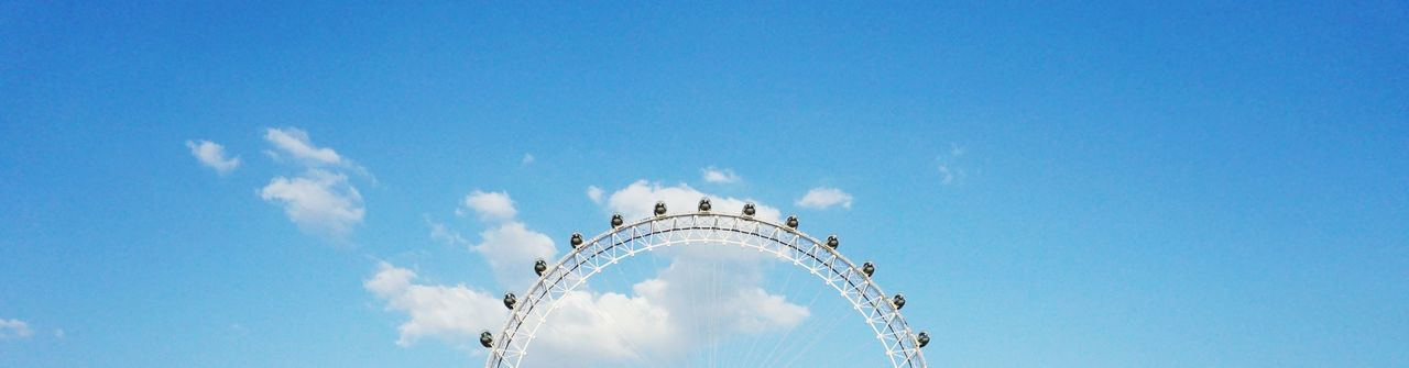 The London Eye London Eye London Clouds And Sky Clouds Divider Header Banner EyeEm Selects Sky Low Angle View Cloud - Sky Architecture Built Structure Nature Day Blue No People Travel Travel Destinations City Outdoors Copy Space