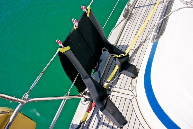 High angle view of wetsuit on ship in sea
