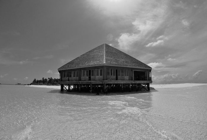 Sanctuary Water Beach Outdoors Stilt House Architecture Tranquility Built Structure Sea No People Nature Day Sky The Architect - 2018 EyeEm Awards