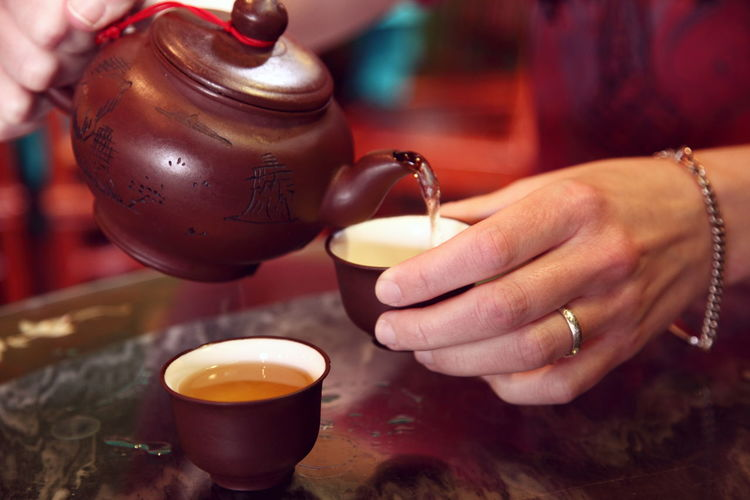 Chinese Tea Chinese Culture Chinese Food Chinese Restaurant Close-up Drink Drinks Food And Drink Freshness Hand Holding Hot Human Body Part Indoors  Part Of Person Real People Restaurant Table Tea Tea House Unrecognizable Person Woman