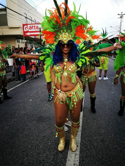Arts Culture And Entertainment Adults Only Celebration Outdoors Full Length Carnival Crowds And Details Happiness Dancing Tradition Green Costume woman