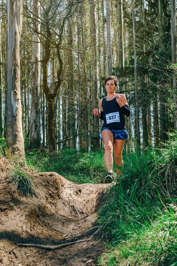 Full length of woman running in forest