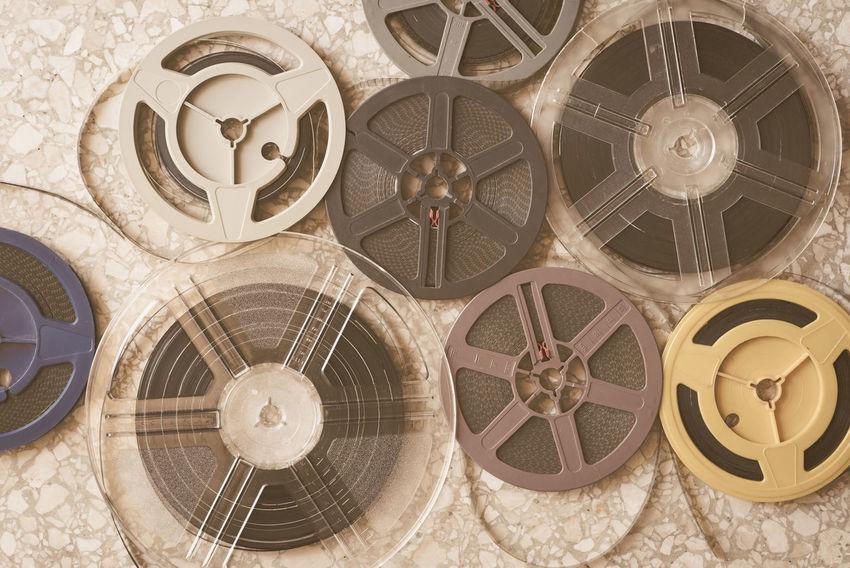 Vintage super 8 movie reels background Aged Background Close-up Day Evocative Film Filmstrips Indoors  MOVIE No People Old Reels Roll Super 8 Symbol Unrolled Filmstrip Vintage