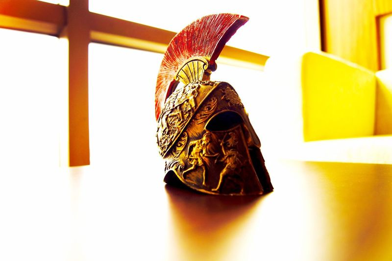 Close-up of cavalry helmet on table by window