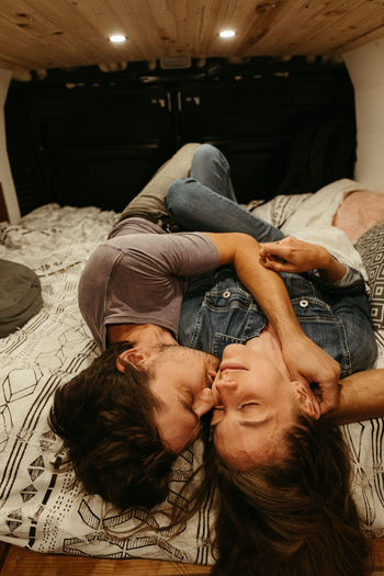 Portrait of couple kissing at home