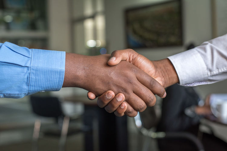 Cropped Image Of Business People Shaking Hands At Office
