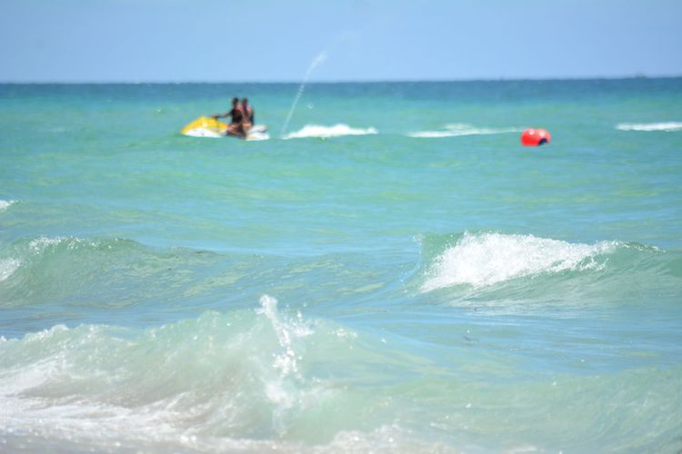 jet skiing along the coast off south Florida Leisure Activity Sport Adventure Water People Outdoors Aquatic Sport Vacations Horizon Over Water Adults Only Jetskiing Jet Skiing Watercraft Ocean Jet Ski Jetski Recreational Vehicle Recreational Activities  Two People Waves Surf