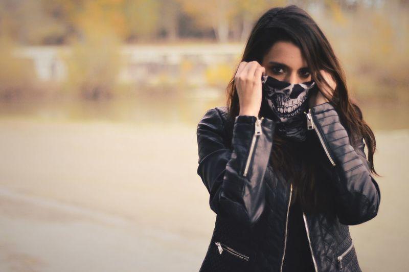 Portrait Of Woman Wearing Skull Print Scarf