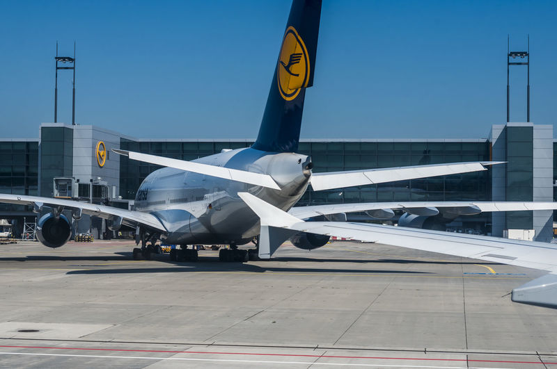 A Lufthansa Airbus A380 in the parking area at Frankfurt airport. A380 BIG Lufthansa Lufthansa A380 Wing Air Vehicle Aircraft Airplane Airport Airport Runway Day Editorial  Frankfurt Airport No People Outdoors Parked Taxiway Transportation
