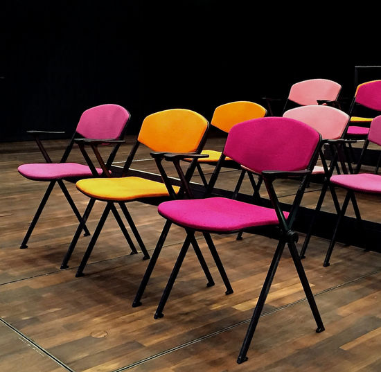 Chair Chairs In A Row Colourful Front Row Front Row Seats Happy Colours Indoors  Lined Up In A Row Modern Furniture Multicolored No People Pink Color Ready To Start Yellow Colour Cover Photo Background For Quotes Vip Presentation Background