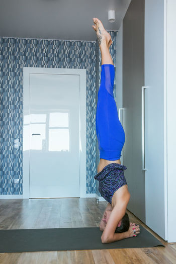 Side View Of Woman Exercising At Home