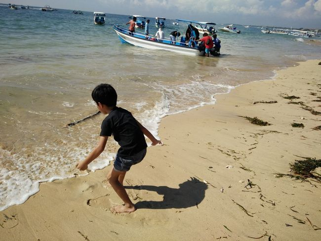 Beach Beauty In Nature Boys Casual Clothing Childhood Day Enjoyment Full Length Fun Leisure Activity Lifestyles Nature Outdoors Sea Shore Sky Tranquil Scene Tranquility Vacations Water Tanjungbenoa Bali, Indonesia Nusadua