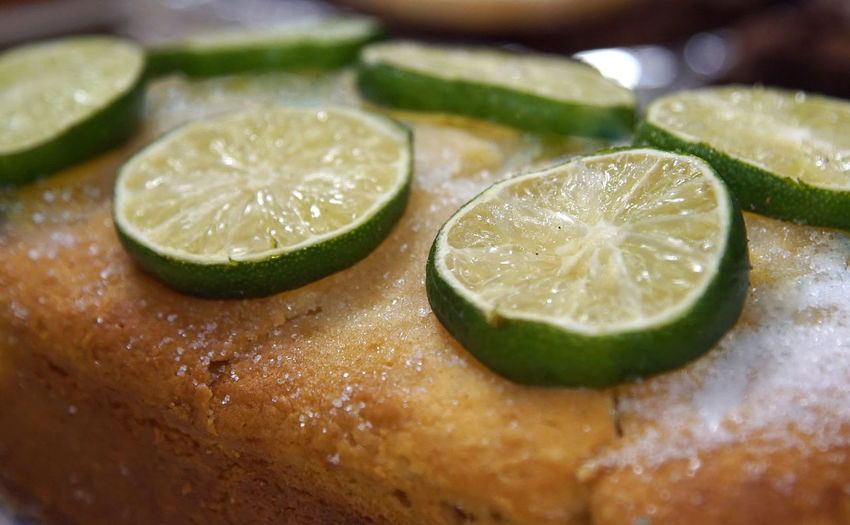 Close-up of lime slices on gin and tonic cake