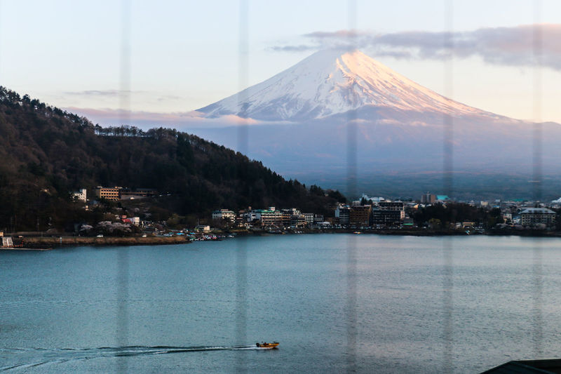 Beauty In Nature Daily Project Fuji Fujisan Lake Lake View Mountain Mountain Range Mt. Fuji Outdoors Reflection Rippled Scenics Snow Snowcapped Mountain Village Volcano Water Outside My Window The Great Outdoors - 2017 EyeEm Awards Light Sky 富士山 EyeEm Gallery Perspectives On Nature