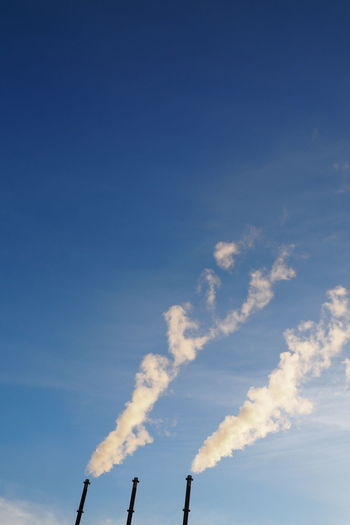 Blue Sky Chimneys Environment Fossil Energy Industrial Industrial Landscapes Outdoors Pollution Sky Smoke Steam Vapors