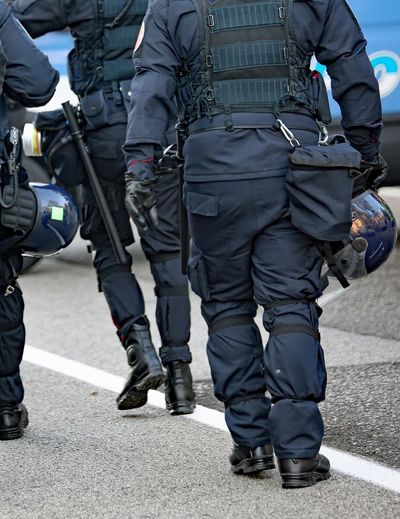 police force in riot gear with protective helmet Man RISK Security Antiterrorism Antiterrorisme Antiterrorist Attack Authority City Group Law Men Occupation Outdoors People Police Police Force Police Uniform Protective Workwear Riot Riotejo Safety Team Uniform Weapon