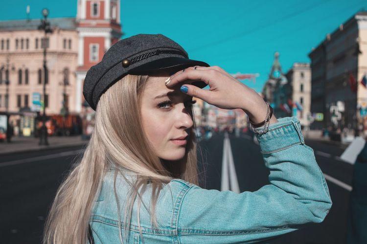 Portrait Of Woman Wearing Hat In City