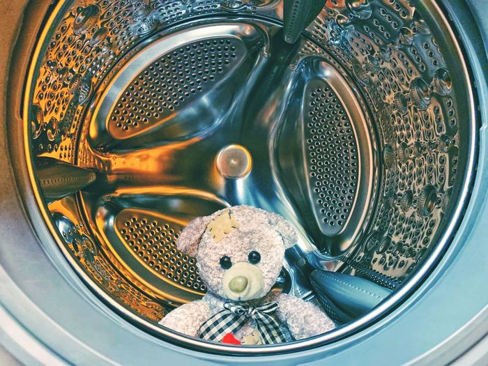 Close-up of teddy bear in washing machine
