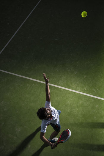 High angle view of man playing with ball