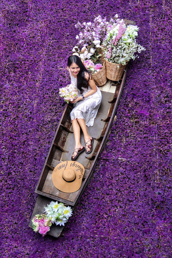 High angle view of woman standing by potted plant
