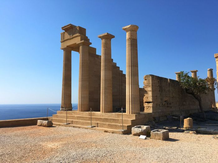 Ruins of doric temple against clear sky