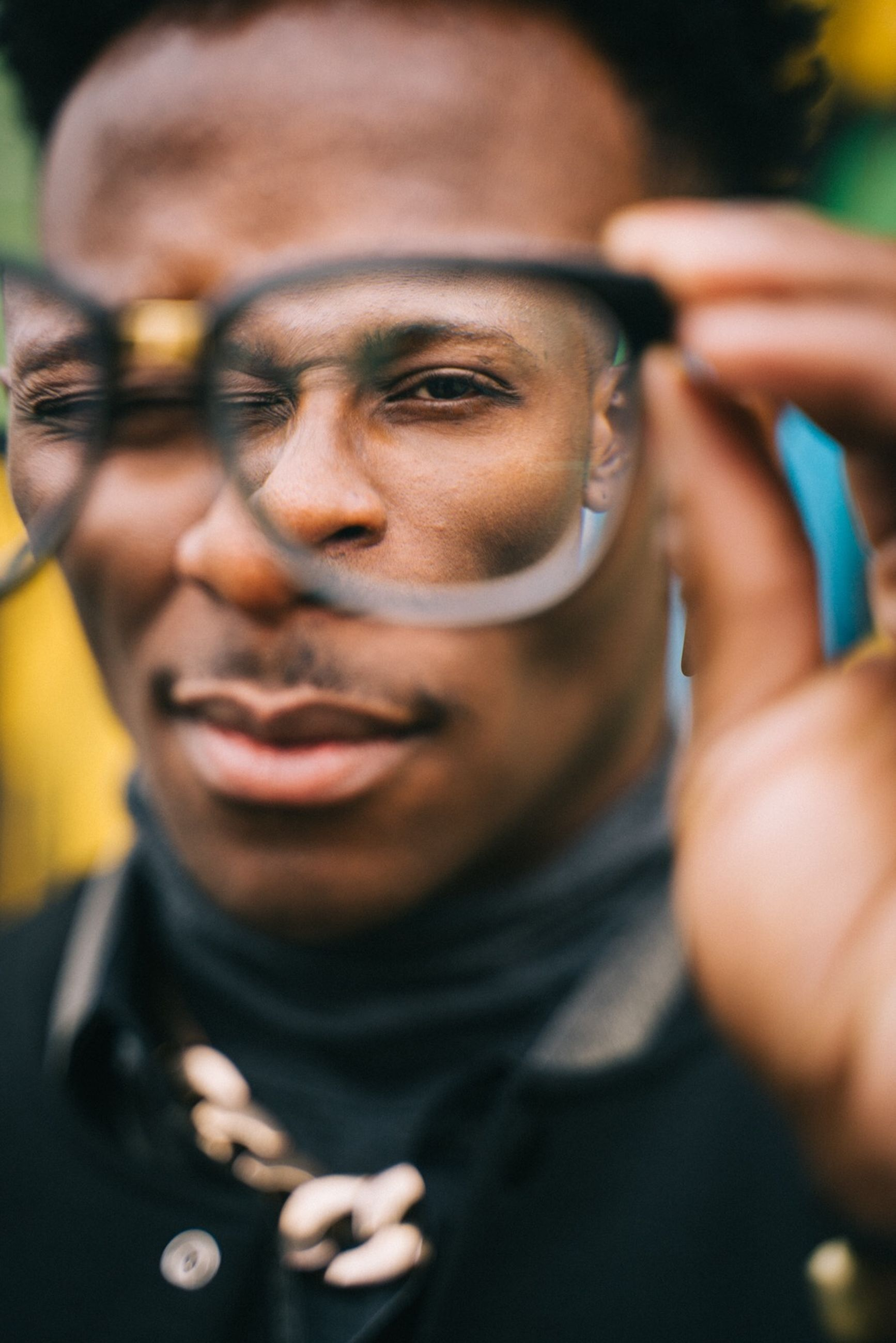 real people, portrait, headshot, one person, front view, lifestyles, adult, selective focus, men, focus on foreground, mid adult, leisure activity, close-up, young adult, looking away, looking, males, casual clothing