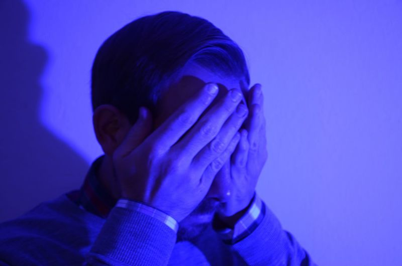 Man Covering Face With Hands Strong Violet Light Blue Embarrassing Headshot One Person Studio Shot Young Adult