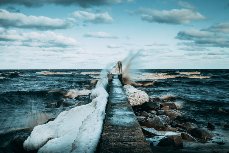 The raw power of the roaring sea. South of Åhus, southern Sweden. EyeEm Best Shots Pier Wave Beach Beauty In Nature Cloud - Sky Crashing Day Horizon Over Water Motion Nature No People Outdoors Scenics Sea Sky Tranquil Scene Tranquility Water Waves