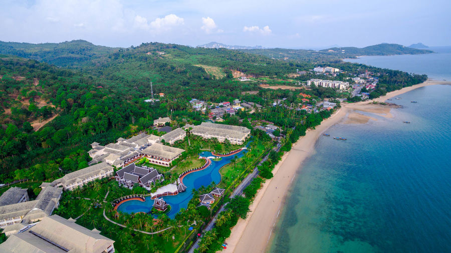 Aerial View Architecture Beach Building Exterior Built Structure Cloud - Sky Day Environment High Angle View Land Luxury Nature No People Outdoors Plant Scenics - Nature Sea Sky Swimming Pool Tree Water