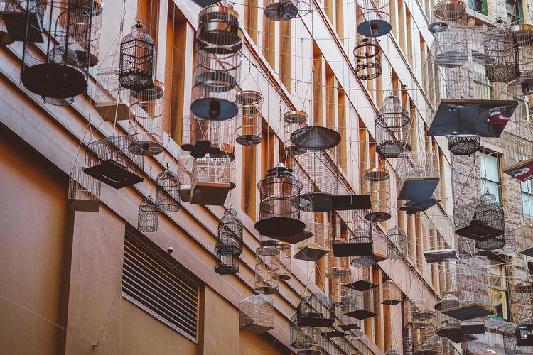 Low angle view of lanterns hanging on wall in building