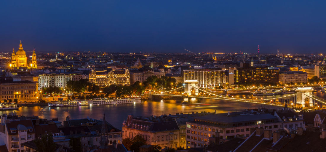 High angle view of szechenyi chain bridge over danube river amidst illuminated city