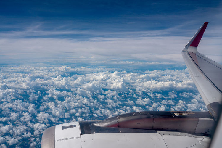 The view outside the airplane window Clouds Above Aerial Air Aircraft Airline Airplane ASIA Atmosphere Aviation Background Bangkok Beautiful Blue Business Clean Cloud Cloudscape Cloudy Engine Fairview Flight Fly Forecast Frame Freedom Glass High Horizon Idyllic Interior Jet Light Nature Plane Sky Sunlight Tourism Transport Transportation Travel Trip Vacation View Weather White Window Wing Mode Of Transportation Aircraft Wing The Traveler - 2019 EyeEm Awards