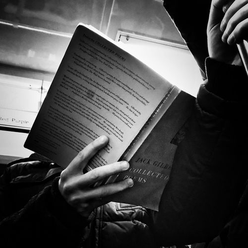 Scenes from the l Reading Rush Hour Blackandwhite Streetphotography CTA Commuter Train Human Hand Real People Text Human Body Part Indoors  Human Finger One Person Book Holding