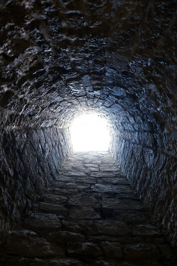 Low angle view of stone wall in tunnel