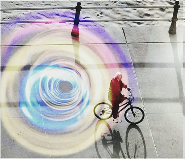 Blurred motion of man riding bicycle in city