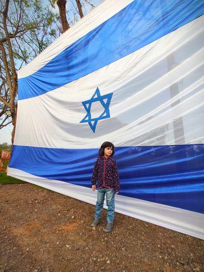 Full length of girl standing by israel flag