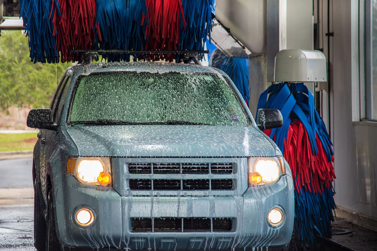 Car covered in suds going through an automated car wash Carwash Car Wash Automated Car Wash Soapy Suds Clean Washing Car Automatic Car Wash