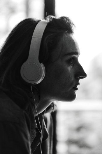 emotive Music Listening Listening To Music Headphones Portrait Close-up Thoughtful Human Lips Pensive Thinking Pretty Profile View Caucasian Introspection Human Face Head And Shoulders