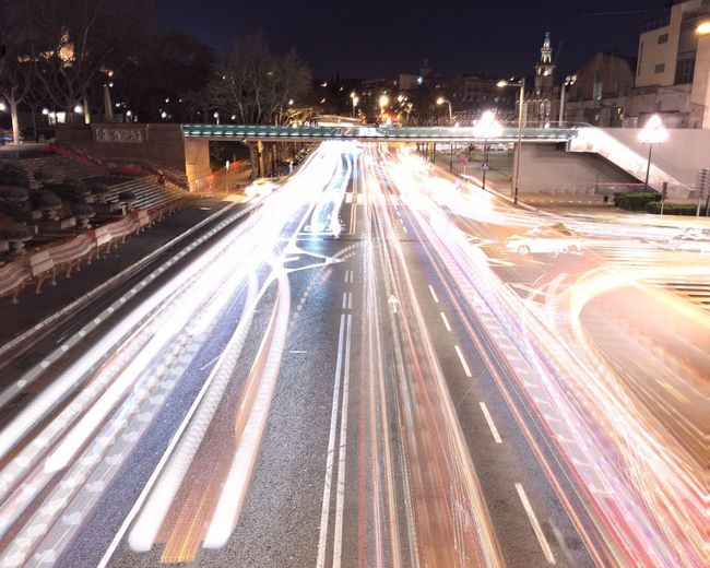 Light trails on city during winter at night