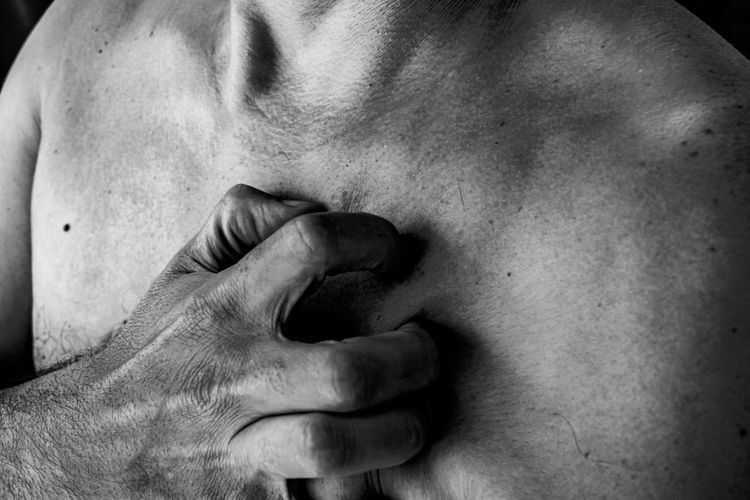 Close-up of shirtless man