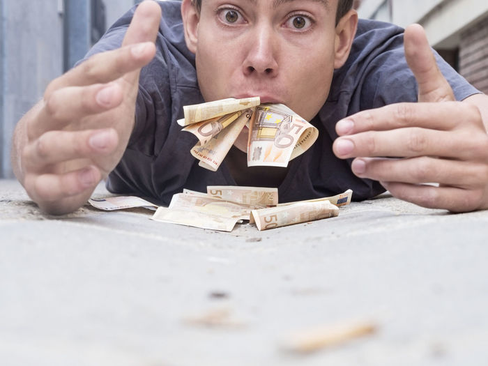 Portrait Of Man Eating Money