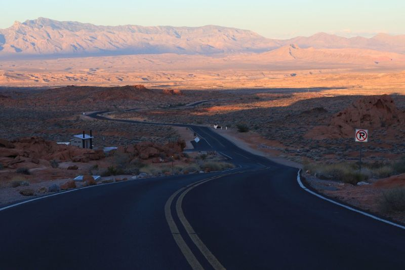Empty road leading towards mountains at valley of fire state park